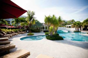 Poolside lounging area at the Royal West Indies