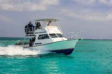 Dive Boat Provo Crusader motors past turks and caicos dive sites